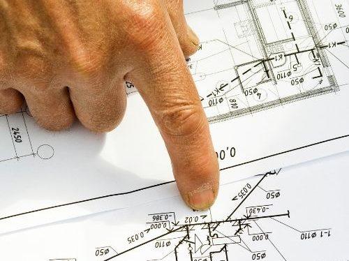 Konstruktionsritning med en Hand